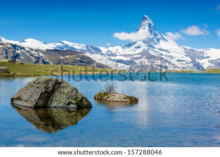 Beautiful summer Alpine mountain lake view - stock photo