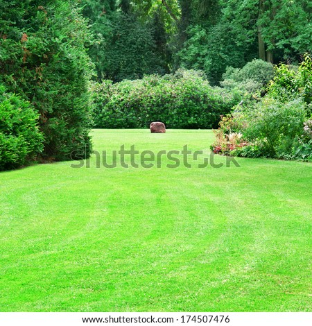 beautiful summer garden with large green lawns - stock photo