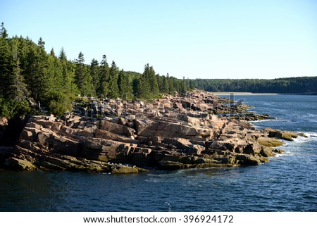 Beautiful summer image of Acadia National Park in Maine with rocks, river and mountains