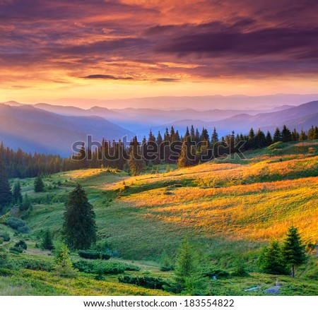 Beautiful summer landscape in the mountains. Dramatic sunset. - stock photo