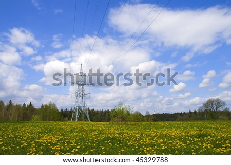 Beautiful summer landscape with high voltage power line