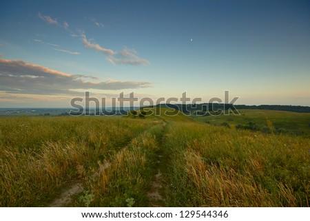 Beautiful summer rural landscape. Rural road. - stock photo