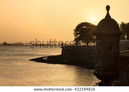 Beautiful summer sunset at the outer wall with sentry box of fort San Felipe del Morro in old San Juan in Puerto Rico - stock photo