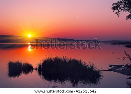 Beautiful summer sunset in the lake. Dusk time