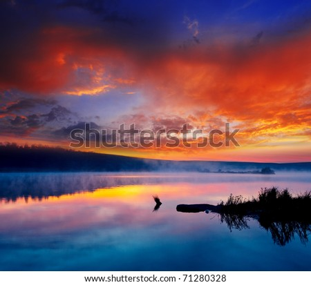 Beautiful summer sunset in the lake. HDR image - stock photo