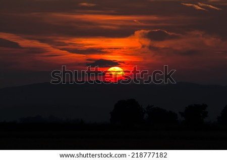 Beautiful summer sunset over the hills. - stock photo