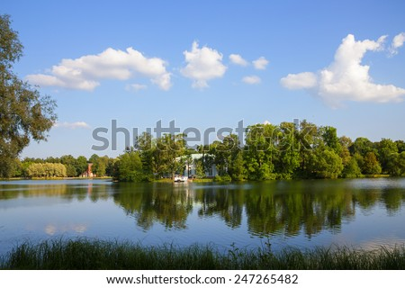 Beautiful summer view at the bank of a river in evening sunbeam - stock photo