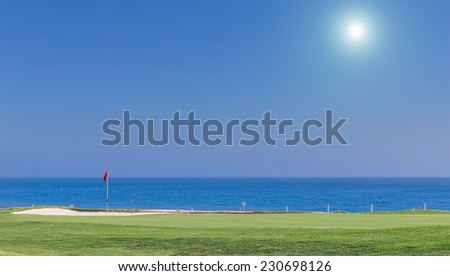 Beautiful summer view of a golf course. With a background of the sea. - stock photo