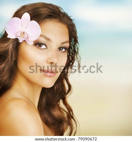 Beautiful Summer Woman on the Beach - stock photo