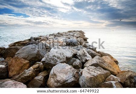 Beautiful sundown before storm coast wiyh rocks of mediterranean sea in spain - stock photo
