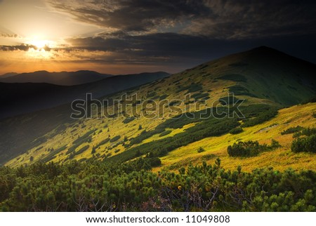 Beautiful sunget mountain landscape (ideal for background or wallpaper) - stock photo