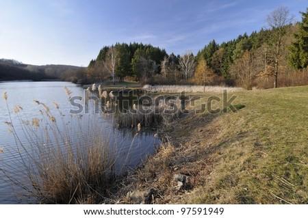 Beautiful sunny winter day on the lake - stock photo