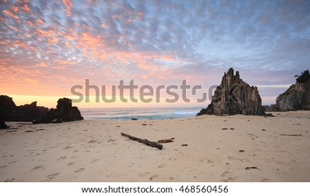 Beautiful sunrise and coloured skies over one of the beaches in Eurobodalla National Park, Mullimburra Point, Meringo which has magnificent rising sea stacks