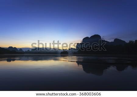 Beautiful sunrise at the nongtalay lake in krabi Province,Thailand - stock photo