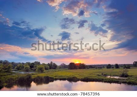 Beautiful Sunrise. Flood waters of Narew river, Poland. - stock photo