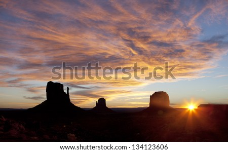Beautiful sunrise in Monument valley. - stock photo