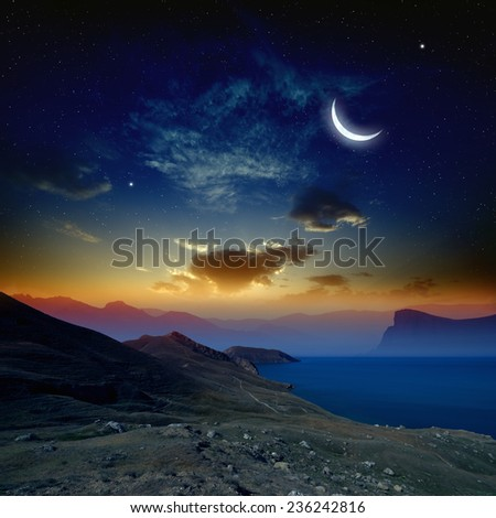 Beautiful sunrise in mountains and sea, glowing horizon, moon and bright stars in dark blue sky. Elements of this image furnished by NASA http://visibleearth.nasa.gov - stock photo