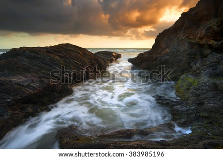 Beautiful sunrise in rocky area taken with Slow Shutter. Soft Focus Motion Blur due to Slow Shutter Speed. Copy Space Area - stock photo