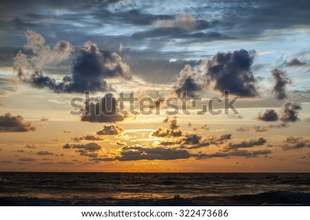 Beautiful sunrise in the Indian Ocean with clouds - stock photo