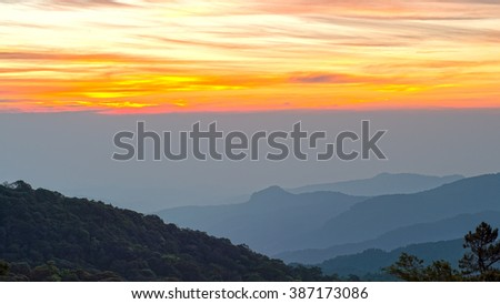 Beautiful Sunrise Landscape of forest ,  tree , mountain in a sunrise morning  - stock photo