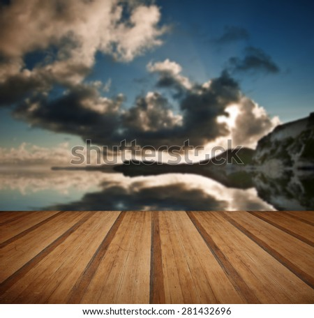 Beautiful sunrise landscape over Mupe Bay on Jurassic Coast in Dorset, England with wooden planks floor - stock photo