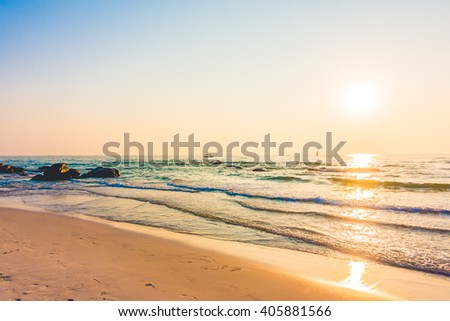 Beautiful sunrise on the beach and sea - Vintage Filter