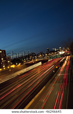 Beautiful sunrise or sunset in Atlanta, Georgia showing city skyline and light streaks from rush hour traffic - stock photo