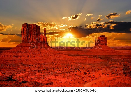 Beautiful sunrise over iconic Monument Valley, Arizona, USA - stock photo