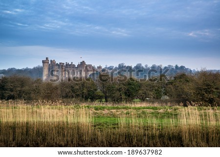 Beautiful sunrise over medieval castle in distant landscape - stock photo