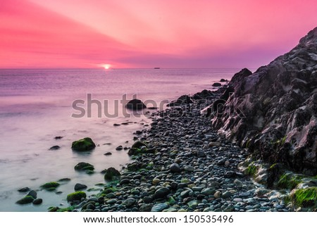 Beautiful sunrise over the Irish Sea at Bray Head in Bray County Wicklow Ireland - stock photo