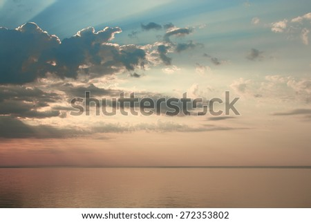beautiful sunrise over the quiet calm sea - stock photo