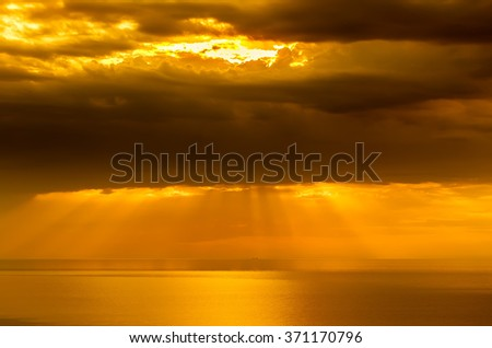 Beautiful sunrise over the quiet calm sea. - stock photo