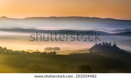 Beautiful sunrise over the valley of olive groves and vines - stock photo