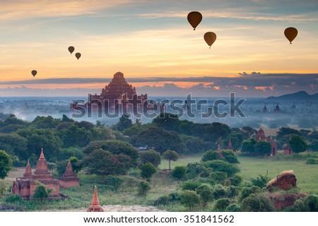Beautiful sunrise scene of Ancient Pagoda in Bagan , Myanmar - stock photo