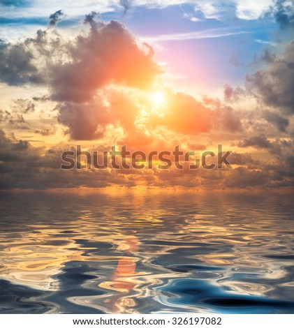 Beautiful sunrise with clouds in the indian sea - stock photo