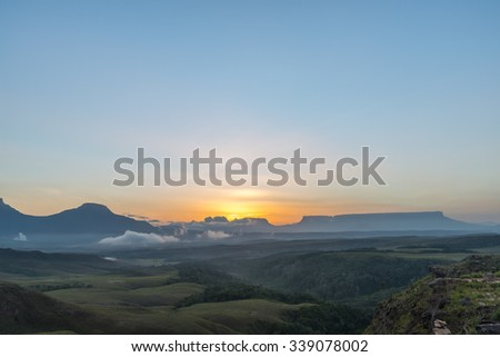 Beautiful sunrise with the the eastern chain tepuys (table-top mountains) on the background, in Canaima National Park, Venezuela - stock photo