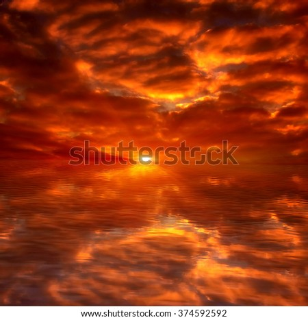 Beautiful sunset above the sea. fiery sunset in the ocean
