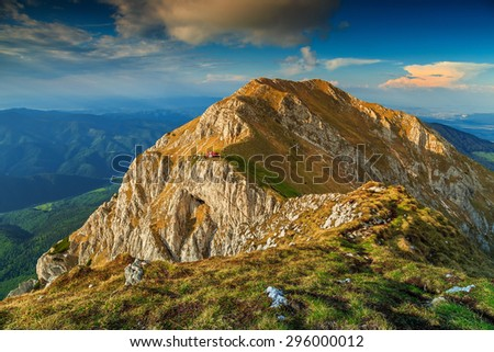 Beautiful sunset and narrow ridges in the Piatra Craiului mountains with a red refuge,Carpathians,Transylvania,Romania,Europe