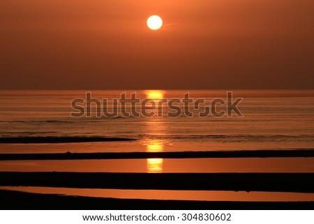 Beautiful sunset and tideland (100 major sunset point in Japan) Matama-sea coast, Oita Japan - stock photo