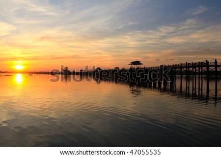Beautiful Sunset at ancient bridge in Myanmar! - stock photo