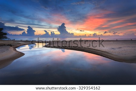 Beautiful sunset at Karon beach in Phuket, Thailand - stock photo