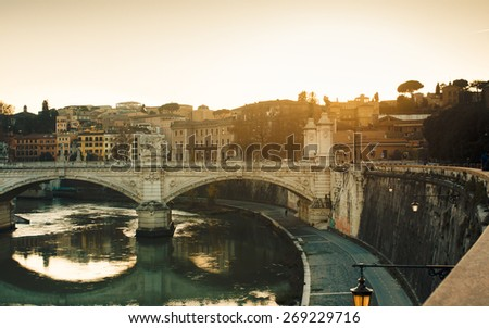 Beautiful sunset at Ponte Vittorio Emanuele II in Rome, Vatican City scenery over Tiber river. - stock photo