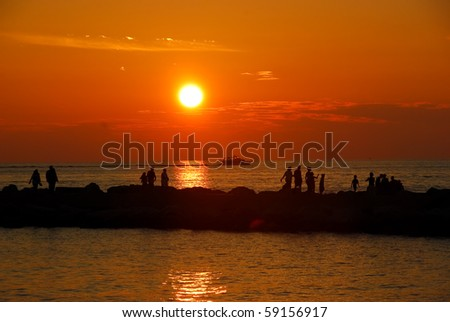 Beautiful sunset at the Holland Pier in Holland, Michigan, USA - stock photo