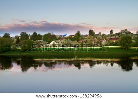 Beautiful sunset in a village in Eastern Europe - stock photo