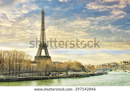 Beautiful sunset in Paris overlooking the Seine and the Eiffel tower. - stock photo