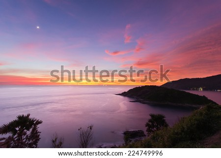 Beautiful sunset in promthep cape is a mountain of rock that extends into the sea in Phuket, Thailand - stock photo