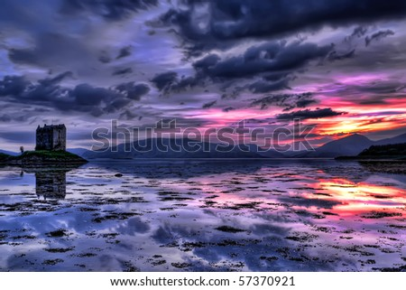 Beautiful sunset in Scotland with Stalker castle in the background - stock photo