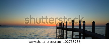 Beautiful sunset in the Florida Keys with boat dock silhouette. - stock photo