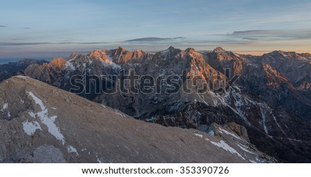Beautiful sunset in the mountains. Image was taken at Mojstrovka mountain in Julian Alps. - stock photo