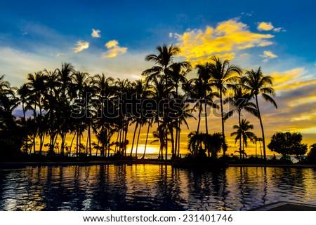 beautiful sunset in tropical beach resort - stock photo